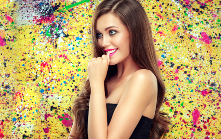 Big expanded eyes and opened mouth, expression of excitement  and big interest on the face young, attractive woman.Telling facial expression. Woman on the abstract style background.