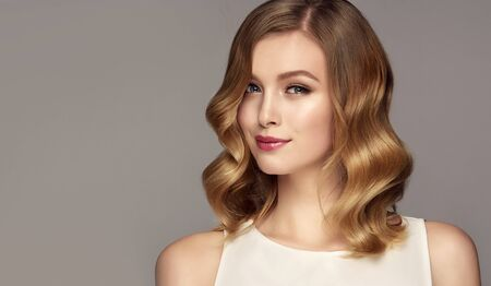 Beauty portrait of young, gorgeous woman. Natural gloss of healthy hair. Hair care and hairdressing art.