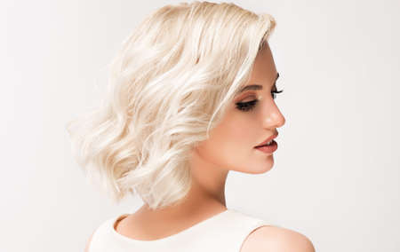 Woman portrait in profile.Young blonde model with middle length hair. Beauty, elegance, hairstyling and cosmetics.
