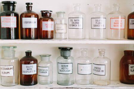 Bottles on the shelf in old pharmacy Stock Photo