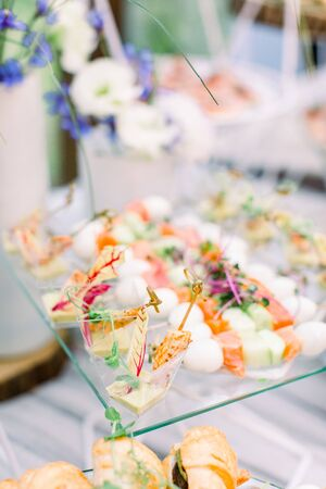 Buffet table of reception with cold snacks, catering concept