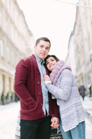 happy loving couple kisses, enjoying Christmas or New year Holidays outdoor, walking on city streets Stok Fotoğraf