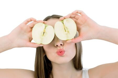 Beauty smiling woman with halfs of apple with healthy skin on face posing on the light background. Attractive fresh vitamin. Studio shoot. Isolated on a white background.