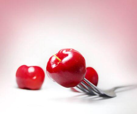 Macro image of cherry on fork