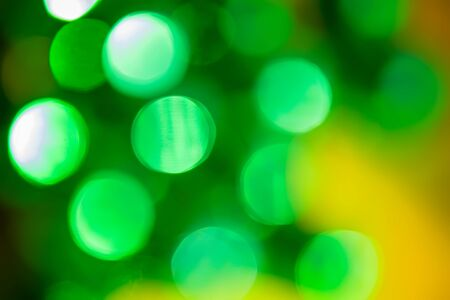 Abstract christmas new year bokeh lights green background 版權商用圖片