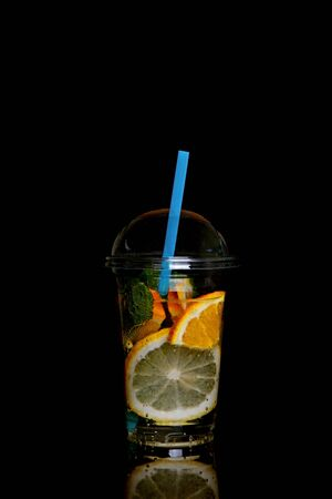A glass of lemonade isolated on a black background. Stock Photo