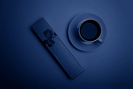 Cup of espresso coffee and gift box in blue tones.. Flatlay. View from above. Stock Photo