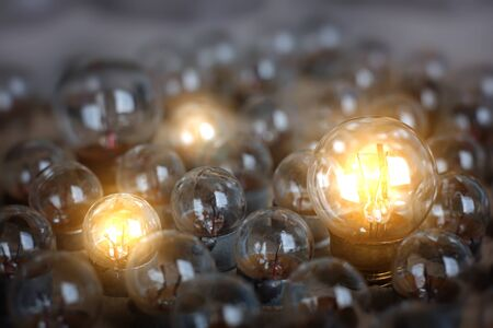Many little light bulbs. Only a few are lighting. The concept of creative and bright people and their ideas.