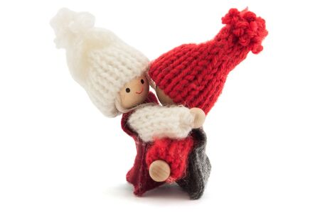sweethearts: embracing sweethearts boy and girl wooden and knitted, on white background