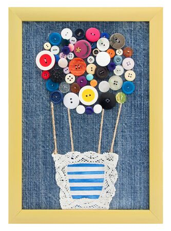 pattern air balloon of buttons in the frame on jeans background for figures; handmade