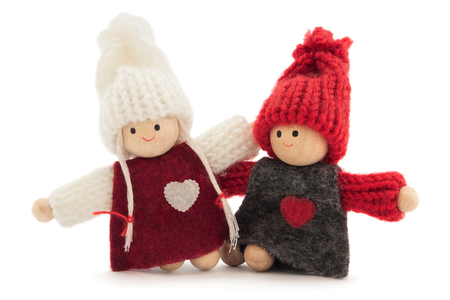 sweethearts: sweethearts boy and girl wooden and knitted, on white background