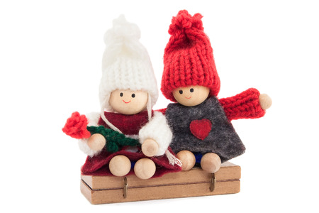 sweethearts boy and girl wooden, knitted, engaged, on white background