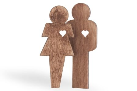 sweethearts: sweethearts man and woman wooden with hearts, isolated on white background