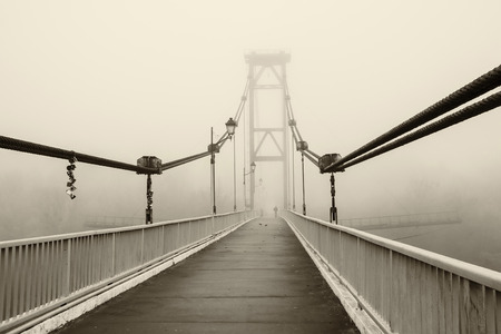 bridge in the fog, black and white