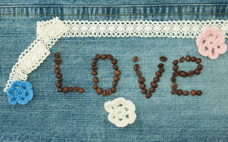 Valentine, greeting card with coffee beans and knitted flowers. Фото со стока