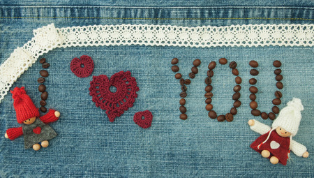 Valentine, greeting card with coffee beans and knitted red hearts, loving couple man and woman.