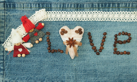 Valentine, greeting card with textile coffee heart, coffee beans and knitted loving couple man and woman. Фото со стока
