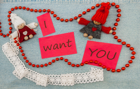 Valentine, greeting card with knitting couple in love and red beads. Фото со стока