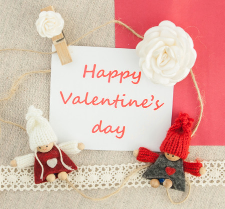 Valentine, greeting card with white roses, pin heart,  knitted loving couple man and woman.