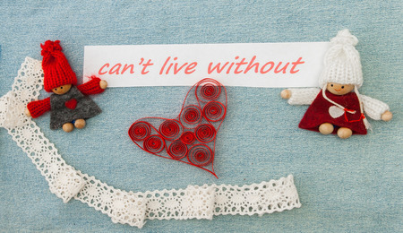 Valentine, greeting card with red quilling heart and  knitting couple in love.