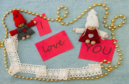 Valentine, greeting card with knitting couple in love and golden beads. Фото со стока