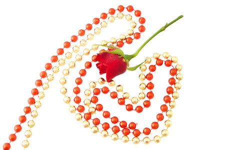 Red little rose, original red and golden hearts of bright and brilliant beads. Фото со стока