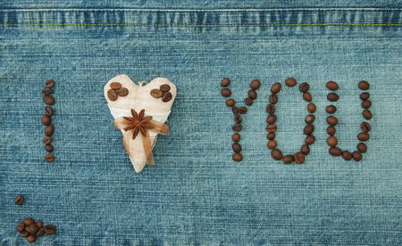 Valentine, greeting card with textile coffee heart and coffee beans. Lettering coffee beans I love you on the denim background. Handmade concept Фото со стока