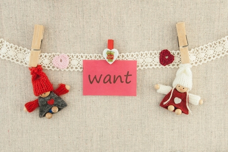 Valentine, greeting card. Wooden pins  knitted loving couple man and woman