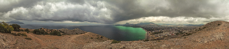 panorama, horizontal view of Crimean mountains with rocky coastline, Black sea before the rain, storm