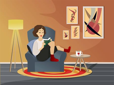 Girl in a chair with a book.