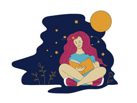 Young girl sitting on the ground reading a book at night