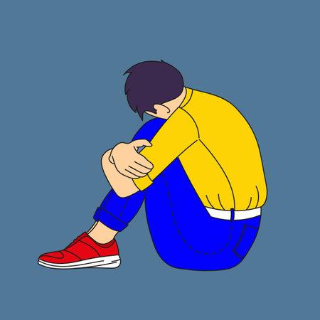Sad guy sitting put his head on his knees.