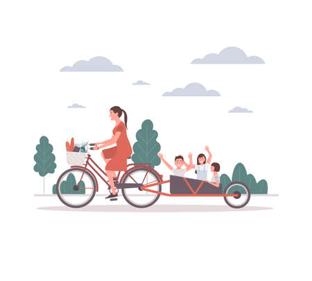 Young mother on a bicycle takes her children for a walk. Children are happy with their mothers for a walk.Mom takes care of the mental and physical well being of her children.