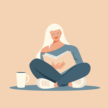 Girl with white hair wearing glasses sitting reading a book. Young student preparing for exams.