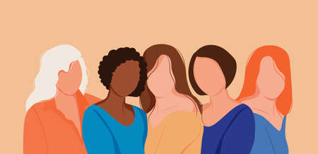 Five young strong confident women standing together.