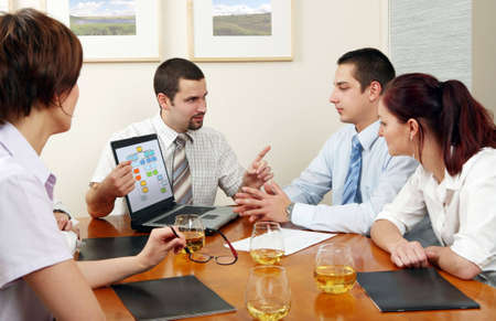 Workgroup interacting in a natural work environment. Stock Photo - 2101652