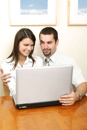 unethical: Affair in the office. Young couple sitting together.