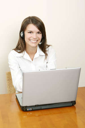 A friendly secretary/telephone operator in an office environment Stock Photo - 2101770