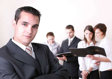 entrepeneur: Successful Business Team in a office environment looking satisfied.