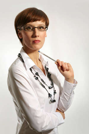 Young business woman wearing glasses, holding pen  photo