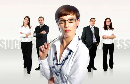 business team with a businesswoman leading it photo