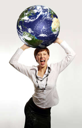online internet presence: Young attractive businesswoman holding the Earth in her hands
