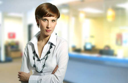 entrepeneur: Businesswoman in a office environment, businessteam in bacground.