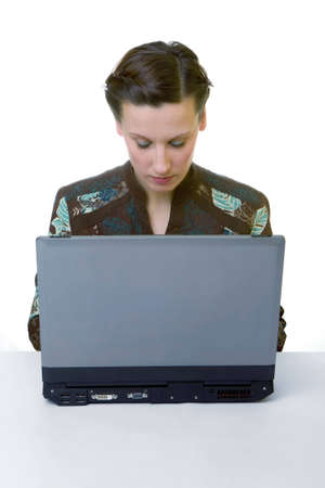 Portrait of an adorable business woman working at her desk with a laptop Stock Photo - 2319818