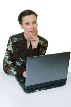 Portrait of an adorable business woman working at her desk with a laptop photo