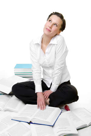 spread around: Casual student with books spread around Stock Photo