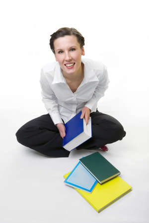 Casual student with books spread around photo