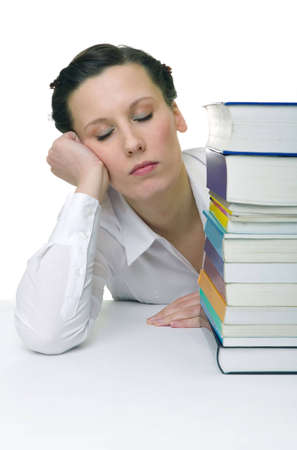 Young woman with piled up books on the desk photo