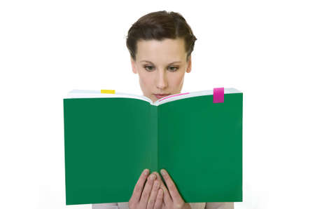 Happy young woman reading a big book photo