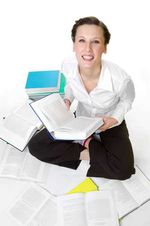 spread around: Casual student with books spread around Stock Photo